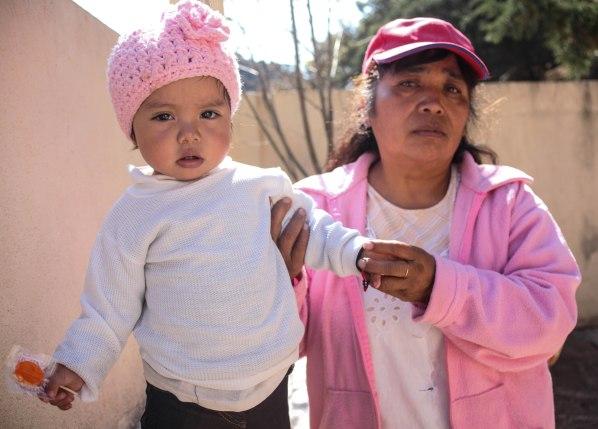 Maria Cristina Aguilar Zarzua, 50, holds her granddaughter. Picture by Maria Esquinca. (2)